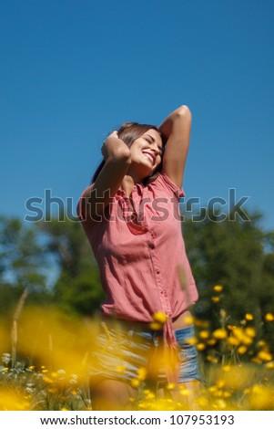 Woman enjoying summer - stock photo