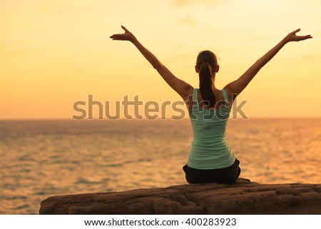 Woman enjoying the ocean view. - stock photo