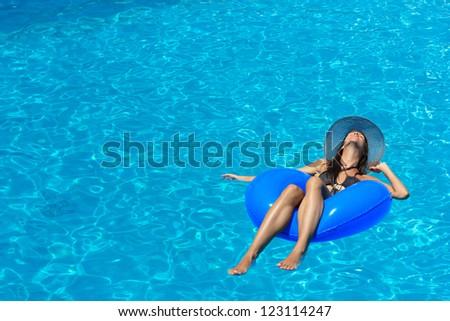 Woman enjoying the swimming pool - stock photo