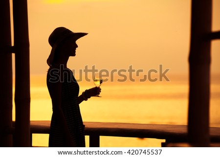 Woman enjoying the view from her hotel room.  - stock photo