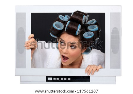 Woman escaping from television set - stock photo