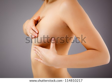 Woman examining breast - stock photo