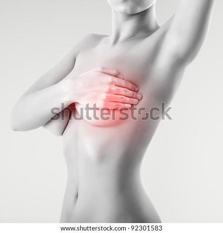 woman examining breast mastopathy or cancer - stock photo