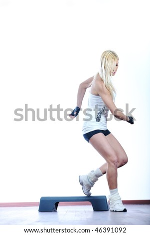 woman exercise fitness and get nice fit shape in fitness sport club indoor - stock photo