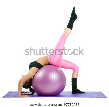 woman exercise stretching her leg on pilates ball - stock photo