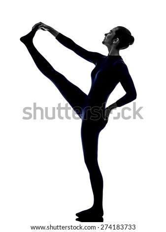 woman exercising Hasta Padangusthasana hand to big toe pose yoga silhouette shadow white background - stock photo