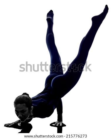 woman exercising Mayurasana peacock pose yoga silhouette shadow white background - stock photo