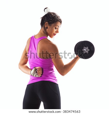 Woman exercising with a dumbbell weight - stock photo