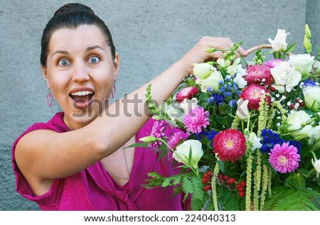 Woman exited about flowers, selective focus - stock photo