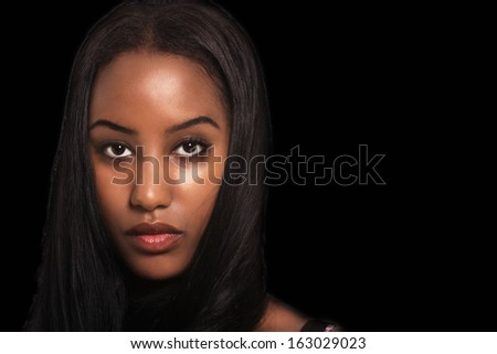 Woman expression, face portrait on dark background - stock photo