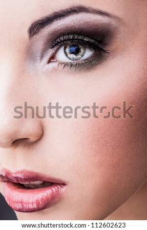 Woman eye with beautiful makeup - stock photo