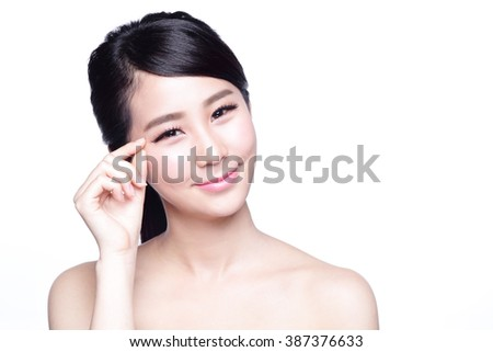 Woman face and eye care and she touch eye with hands, asian beauty - stock photo