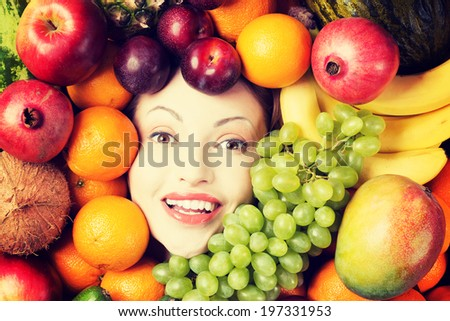 Woman face in fruits, healthy nutrition and diet concept. - stock photo
