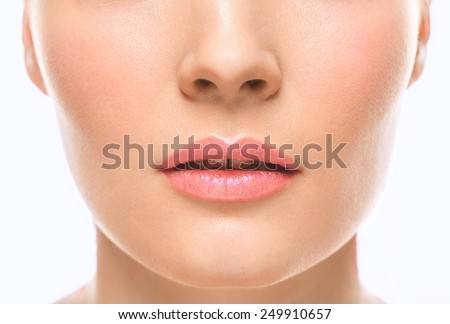 Woman face lips and nose studio white background - stock photo