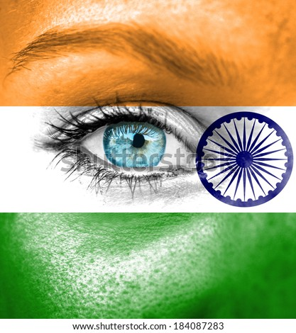 Woman face painted with flag of India - stock photo