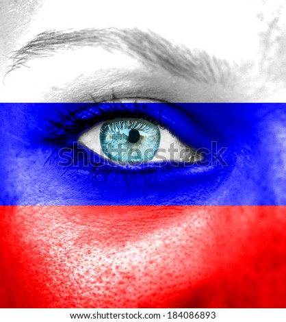 Woman face painted with flag of Russia - stock photo
