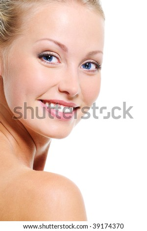 Woman face with a nice smile and healthy beautiful clear skin over white background - stock photo
