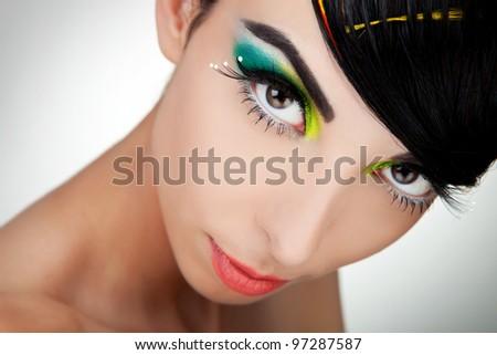 Woman face with beautiful makeup closeup picture - stock photo
