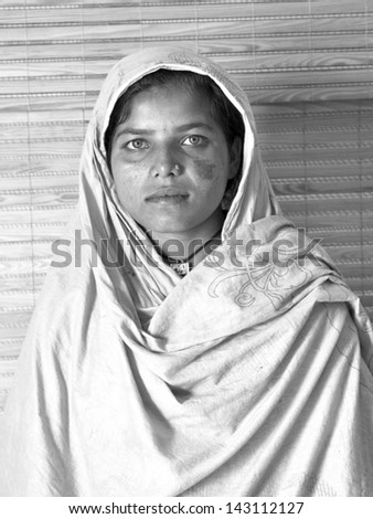 woman face with color eyes and scarf wrapped around head  - stock photo
