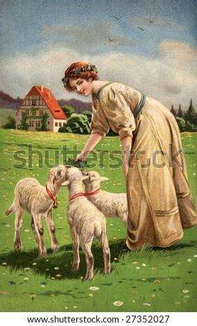 Woman feeding lambs on Easter - A Victorian illustration, circa 1913 - stock photo