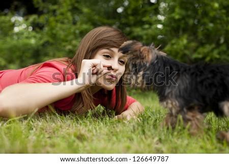 Woman feeding puppy - stock photo