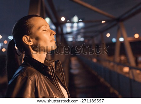 Woman feeling at peace in the city.  - stock photo