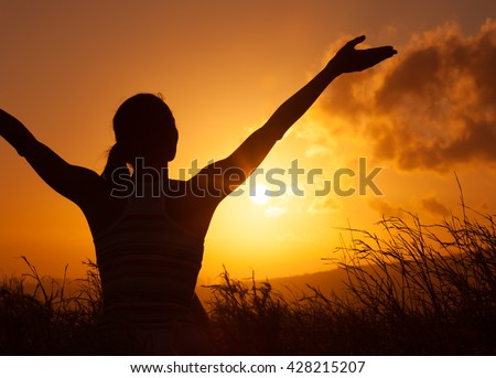 Woman feeling free in a nature setting.  - stock photo