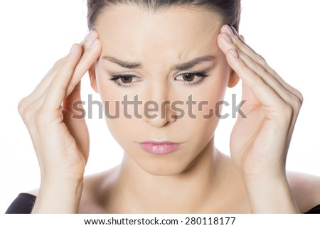 Woman feeling headache - stock photo