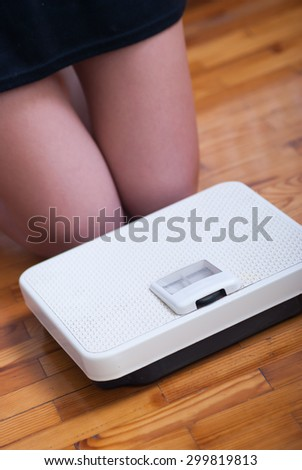 Woman feet and time for weight truth from a scale - stock photo