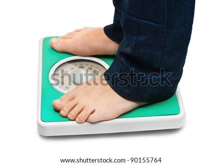 Woman feet and weight scale isolated on white background - stock photo