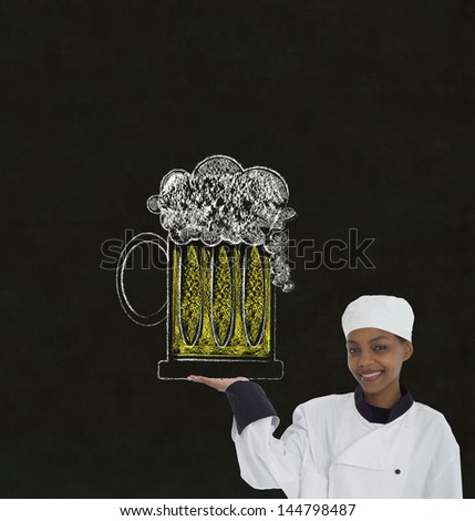 Woman female African or African American chef holding beer drink on chalk blackboard background - stock photo