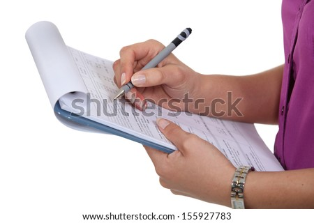 Woman filling in a form - stock photo