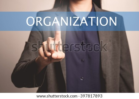 woman finger pointing at the camera with organization word - stock photo