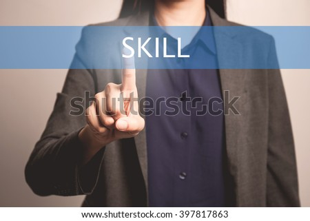 woman finger pointing at the camera with skill word - stock photo
