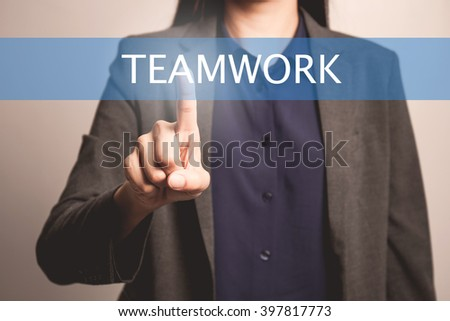 woman finger pointing at the camera with teamwork word - stock photo