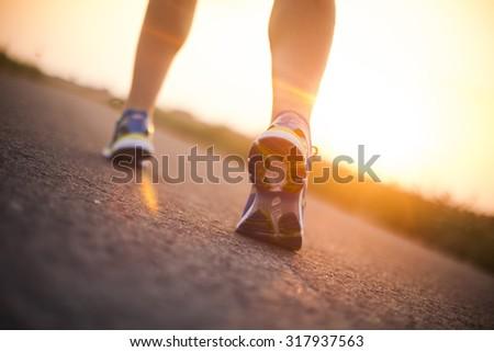 Woman fitness, Runner feet running - stock photo
