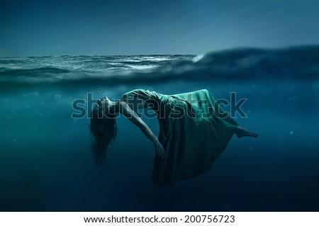 Woman floating underwater - stock photoWoman Floating Underwater