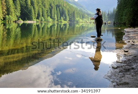 woman fly fishing - stock photo