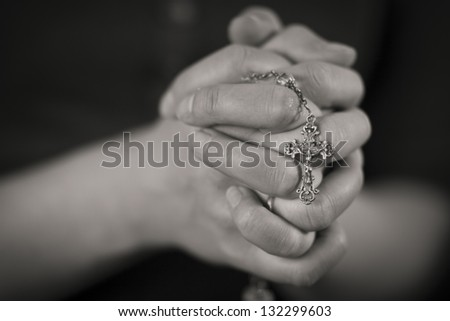 Woman folding hands and pray to God. - stock photo