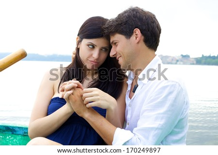 Woman forgiving smiling husband - stock photo