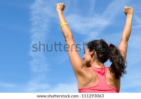 Woman freedom happy concept. Successful woman raising arms to clear blue sky. Beautiful and joyful caucasian girl. - stock photo