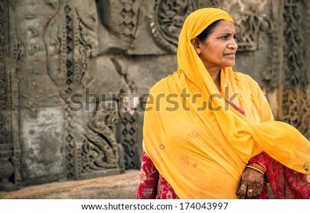 Woman from Delhi standing inside a temple circa May 2013, Delhi, India. - stock photo