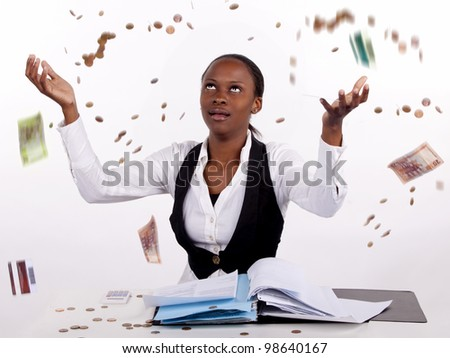 Woman frustrated with finances throws money and hands in the air. - stock photo