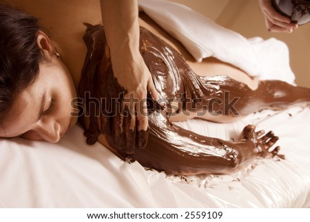 woman getting a chocolate rub at a local spa - stock photo