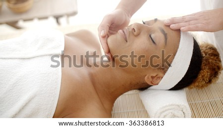 Woman Getting A Face Massage - stock photo