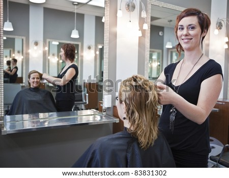 Woman getting a haircut at a beauty salon - stock photo