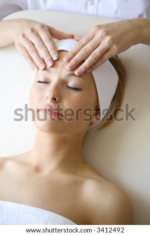 Woman getting facial massage - stock photo
