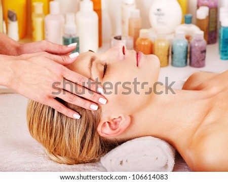 Woman getting facial  massage in beauty spa. - stock photo