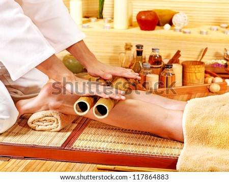 Woman getting feet massage Male therapist. - stock photo