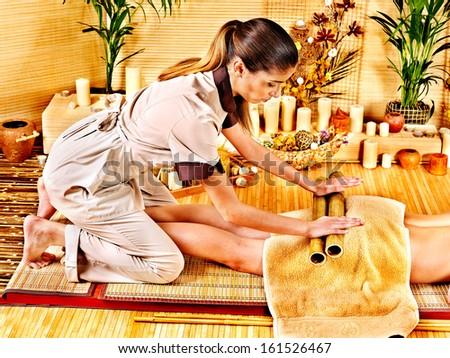 Woman getting feet massage. Male therapist. - stock photo